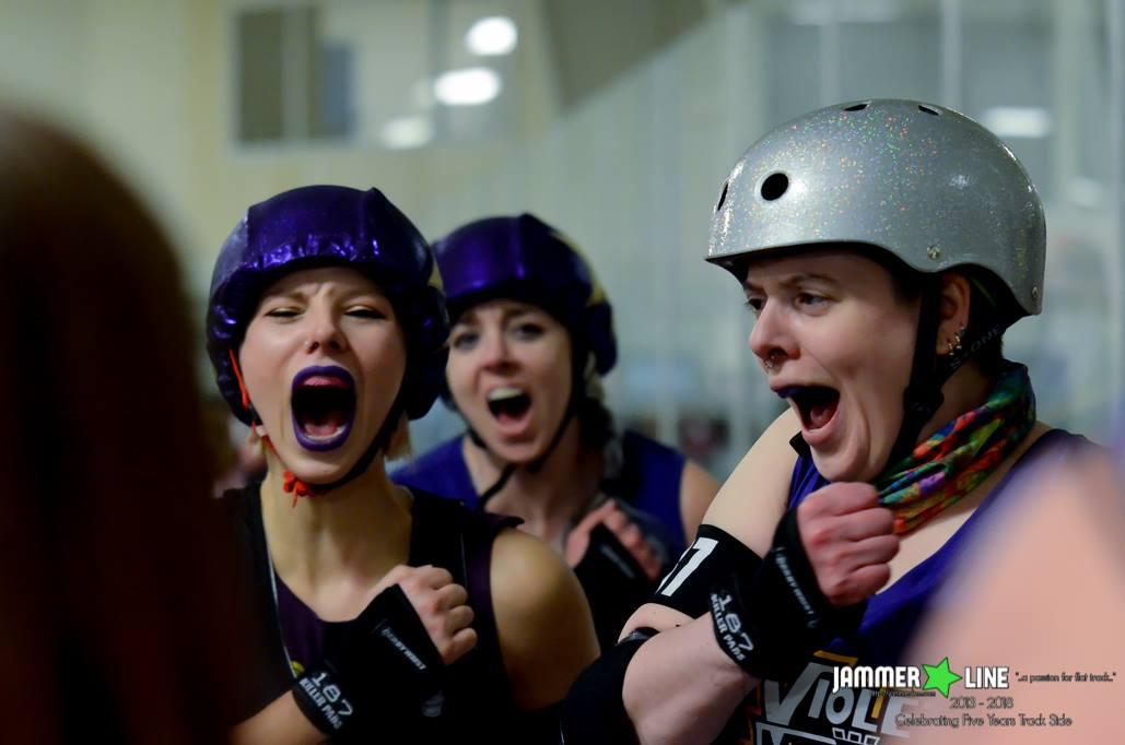 Violet Uprising skaters do a team cheer. Photo credit  Jammer Line.